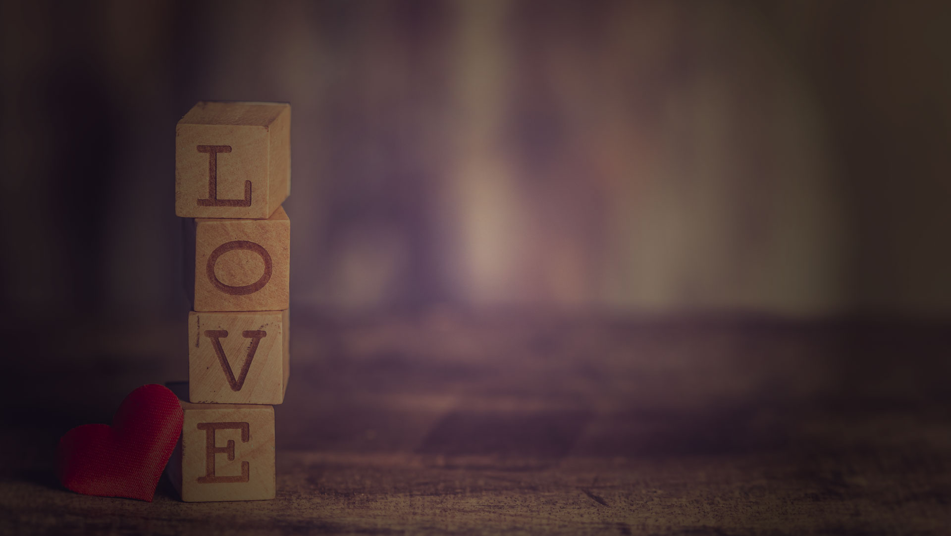 Thumbprint Media's about banner with wooden blocks spelling the word love