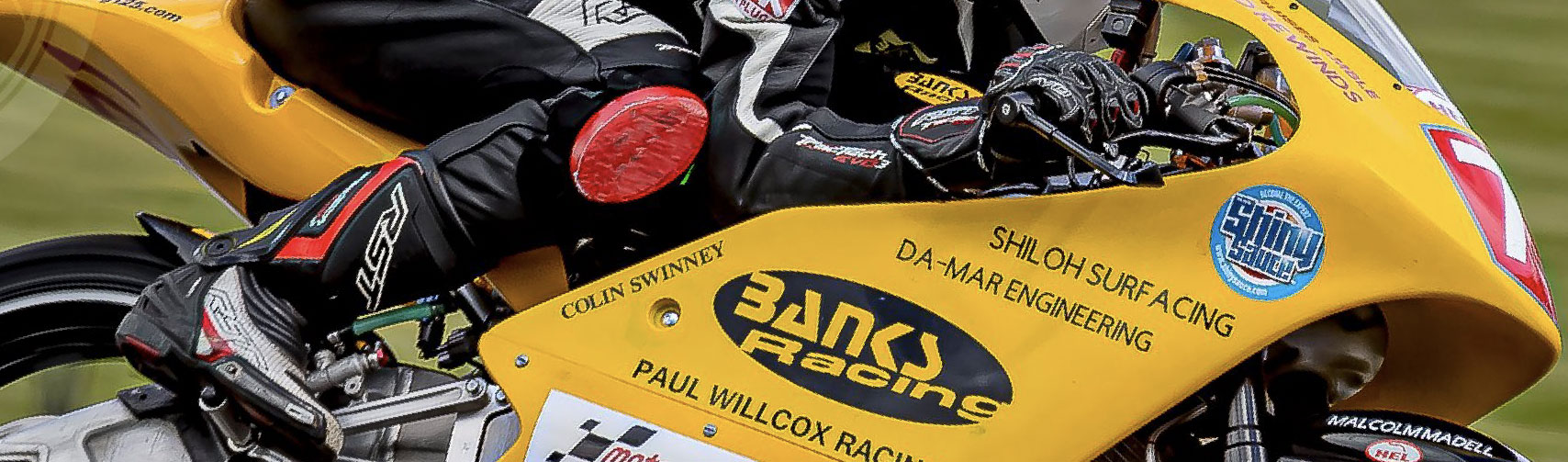 Banks team racing in action banner.