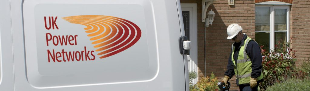 UK Power Networks Van and Engineer outside a property