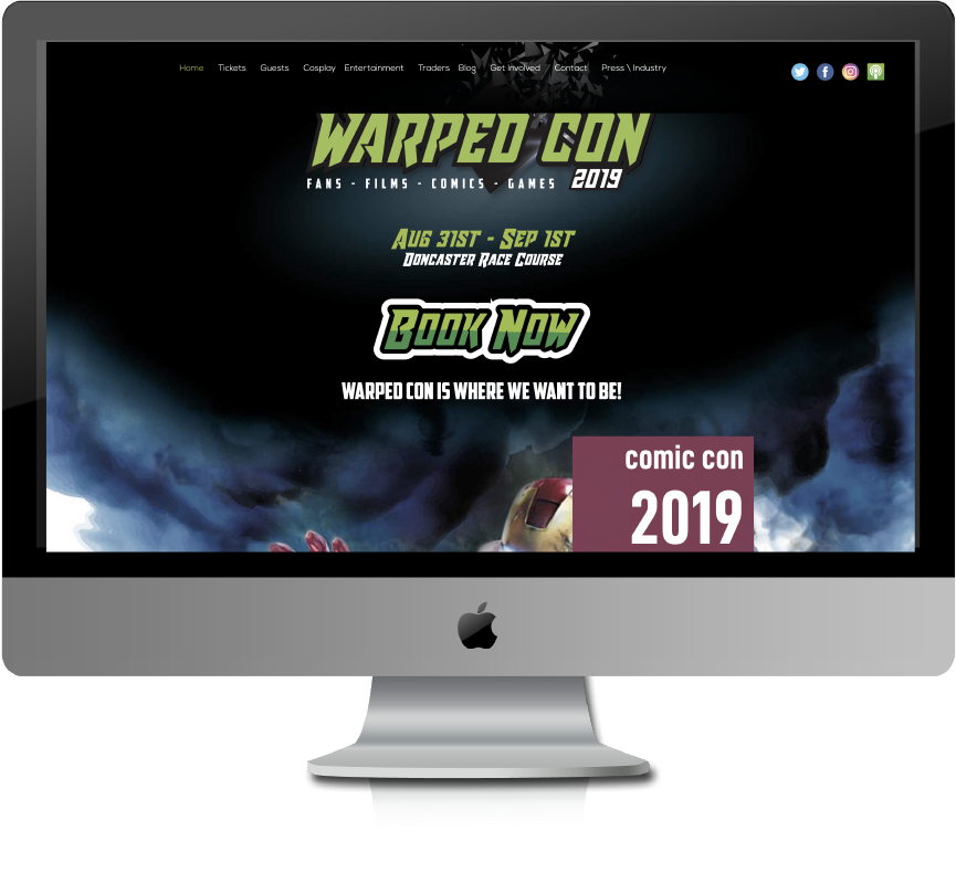 Warped con website displayed on iMac Screen