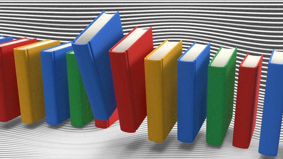 Image of books evenly spaced in the google colours.
